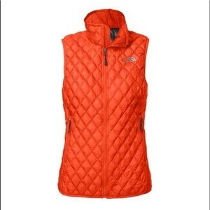 The North Face orange thermoball vest